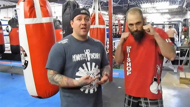 Brad Foster, left, the owner of Kamikaze Punishment Foundation, stands with Mikey Henley, an amateur boxer and comedian, before his charity match. Henley raised $800 for the Make-A-Wish Foundation. Photo supplied.