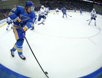 Vladimir Tarasenko of the St. Louis Blues prepares to face two Toronto Maple Leafs players (Getty Images)