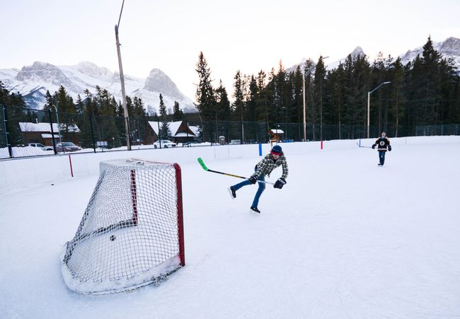 Jordan Lint (front) and Jordan Maher fire pucks at the net on the ice hockey rink at Larch Park in Canmore, Alta., on Sunday, Feb. 12, 2017. (Daniel Katz/ Crag & Canyon/ Postmedia)
