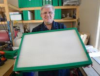 Peter Bruijns, president of Breatheclean Inc., shows a new re-usable furnace filter he has developed in his workshop in Coldstream, Ontario on Monday February 13, 2017 (MORRIS LAMONT, The London Free Press)