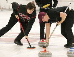 St. Charles' Max Cull (left) and Andrew Kohut sweep during the high school boys city curling final at Sudbury Curling Club on Wednesday. The Cardinals boys and the Lockerby girls claim gold medals. Gino Donato/The Sudbury Star