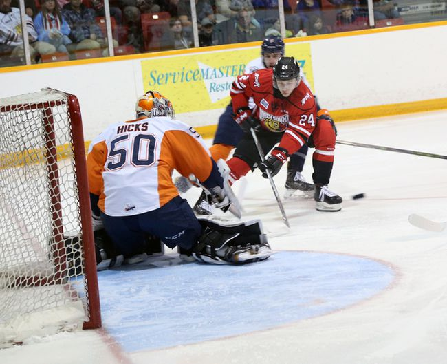 The Owen Sound Attack's Maksim Sushko (right) drives to the net on Flint Firebirds goalie Connor Hicks (left) during first period Ontario Hockey League action on Wednesday. Photo by Bill Walker (Sun Times/Postmedia Network)