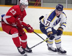 Laurentian Voyageurs' Andrew Tessier and McGill Redmen's Redgie Bois battle for the puck during OUA men's playoff hockey action at Gerry McCrory Countryside Arena on Wednesday night. Gino Donato/The Sudbury Star/Postmedia Network
