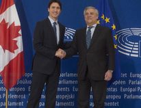 Prime Minister Justin Trudeau (left) is greeted by the President of the European Parliament, Antonio Tajani, as he arrives at the European Parliament in Strasbourg, France, on Thursday, Feb. 16, 2017. (Adrian Wyld/The Canadian Press)