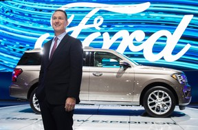 Ford Canada president Mark Buzzell poses in front of the 2017 Ford Expedition during the Canadian International Autoshow, in Toronto on Thursday, February 16, 2017. (THE CANADIAN PRESS/Mark Blinch)