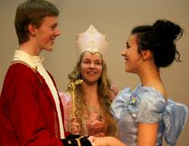 Fairy Godmother (Hailey Hayes) watches the Prince (Jackson Allen) and Cinderella (Gabrielle Turgeon) in a scene from Rodgers and Hammerstein's Cinderella.