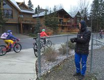 A parent volunteer makes traffic observations on the route to Lawrence Grassi Middle School in Canmore, Alta. in October 2016. (Supplied)