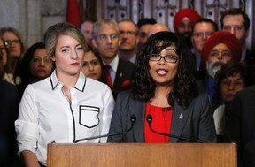 Liberal MP Iqra Khalid makes an announcement about an anti-Islamophobia motion on Parliament Hill while Minister of Canadian Heritage Melanie Joly looks on in Ottawa on Wednesday, Feb. 15, 2017. THE CANADIAN PRESS/Patrick Doyle