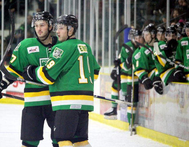 Portage Terriers' forward Ty Enns, right, and Mackenzie Dwyer, left, celebrate following Enns' empty netter. (Brian Oliver/The Graphic)