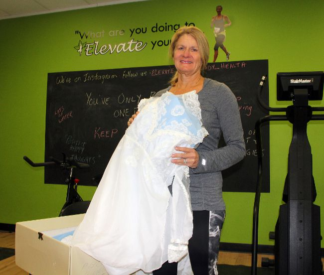 Laurie Johnson, program co-ordinator for Live It Up – Empowering Young Girls, and the manager of the Elevate Your Health and its Youth Fitness Centre, removes a wedding dress from its box in preparation for the Bridal Ball, being held March 4 from 8 p.m. to 1 p.m., at the Clarion Hotel, formally the Travelodge in Pembroke. The proceeds from this unique event will be going toward an expansion at the Youth Fitness Studio.