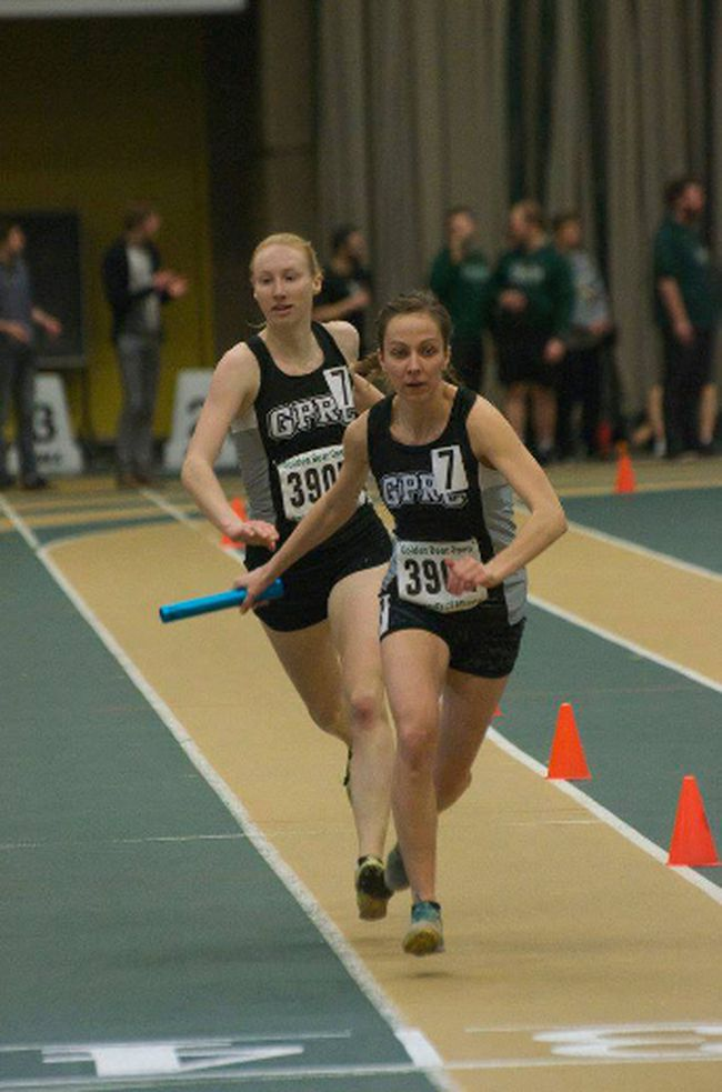Janai Martens hands the baton to Maria Houle in the 4 x 400m relay in Edmonton last weekend.