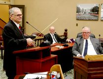 Brockville economic development director Dave Paul, left, uses a measuring tape to deliver a life lesson while operations director Conal Cosgrove, centre, and councillor Jeff Earle listen on Tuesday. (RONALD ZAJAC/The Recorder and Times)