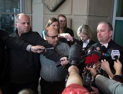 Crown Prosecuters Shane Parker and Vicki Faulkner speak to members of the media at Calgary Courts in Calgary, Alta., on Thursday February 16, 2017, after Douglas garland is charged with first-degree murder. Leah Hennel/Postmedia
