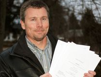 Waterford District High School science teacher Tim Sullivan, of Simcoe, is scheduled for a disciplinary hearing next week before the Ontario College of Teachers following a series of incidents at WDHS in 2015 related to a vaccination clinic. Here, Sullivan displays product monographs related to some of the vaccinations administered to local high school students. MONTE SONNENBERG / SIMCOE REFORMER