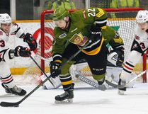 North Bay Battalion defenceman Brady Lyle (22) controls a rebound in his end as Niagara IceDogs Johnny Corneil (23) and Kiriill Maxsimov (13) get ready to back-check during OHL action at Memorial Gardens, Thursday. North Bay won its 20th game of the season and 10th at home with a 4-1 decision bringing them within a point of the eighth playoff position in the Eastern Conference. Dave Dale / The Nugget