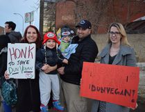 About 40 people showed up to rally in support of Dunvegan Gardens before an appeal hearing regarding the municipality's stop work order against the gardens. From left to right, Heather Kutanzi, 3-year-old son Andrew, Matt Allen and their 6-month-old son Lucas, and Monica Raike stand outside city hall in Fort McMurray Alta. on Thursday, Feb. 16, 2017. Cullen Bird/Fort McMurray Today/Postmedia Network