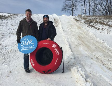 Steelway co-president Bryan White, left, and St. Thomas Elgin General Hospital Foundation executive director Paul Jenkins show off 2017 World Tubing Championship run at the McCaig Family International Tubing Park Friday morning. About 50 teams will be competing for top honours at the second annual STEGH Foundation fundraiser Feb. 18 and 19. (Jennifer Bieman/Times-Journal)