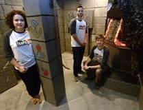 Valerie Charlebois, Derek Noon, and Chris Toth in their escape room business called Trapdoor London. (MORRIS LAMONT, The London Free Press)