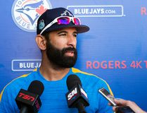 Toronto Blue Jays right fielder Jose Bautista speaks with reporters during baseball spring training in Dunedin, Fla., on Friday, February 17, 2017. (THE CANADIAN PRESS/Nathan Denette)