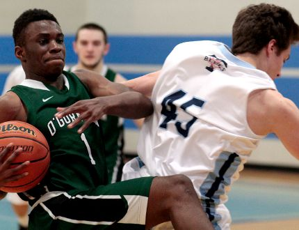 Jonathan Okonmah, left, of the O'Gorman Sr. Knights and Jacob Michaud of the TH&VS Sr. Blues battle for the ball during the last meeting of the NEOAA Central Senior Boys Basketball season at TH&VS on Thursday. The Sr. Blues took a slim 39-36 win as both teams now look to book separate spots to the upcoming OFSAA Championships. BENJAMIN AUBÉ/THE DAILY PRESS