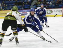 Ryan Valentini, right, of the Sudbury Wolves, attempts to get around Adam Thilander, of the North Bay Battalion, during OHL action at the Sudbury Community Arena in Sudbury, Ont. on Friday February 17, 2017. John Lappa/Sudbury Star/Postmedia Network