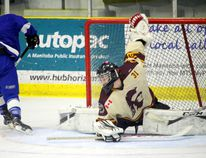 PCI goalie Parker Page stretches all the way out to deny a Carman skater in alone. (Brian Oliver/The Graphic)
