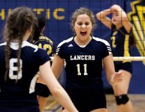 Ursuline Lancers' Sammi Vlasman (11) celebrates after winning a point against the CKSS Golden Hawks in the LKSSAA 'AAA' senior girls volleyball final Friday at Chatham-Kent Secondary School. (MARK MALONE/The Daily News)