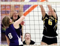Blenheim Bobcats' Riley Rotschenk (6) and Larysa Ainsworth try to block Chatham Christian Flames' Abby Sluys during the LKSSAA 'A' senior girls volleyball final Friday at Chatham Christian High School. (MARK MALONE/The Daily News)