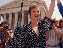 In this April 26, 1989 file photo, Norma McCorvey, Jane Roe in the 1973 court case, left, and her attorney Gloria Allred hold hands as they leave the Supreme Court building in Washington after sitting in while the court listened to arguments in a Missouri abortion case. (AP Photo/J. Scott Applewhite, File)