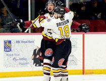 Timmins Rock forwards Cole Gilligan, left, and Alexandre Brisson celebrate Gilligan's first-period goal during Saturday night's NOJHL game at the McIntyre Arena. Gilligan's goal put the Rock in front 2-1 in a game they would go on to win 4-3. The victory allowed the Rock to pull within eight points of the idle Cochrane Crunch in the battle for second place in the NOJHL's East Division standings.  THOMAS PERRY/THE DAILY PRESS