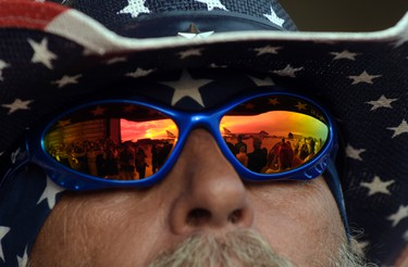 """Air Force One is reflected in a pair of sunglasses as President Donald Trump arrives to speak at his """"Make America Great Again Rally"""" at Orlando-Melbourne International Airport in Melbourne, Fla., Saturday, Feb. 18, 2017.  (AP Photo/Susan Walsh)"""