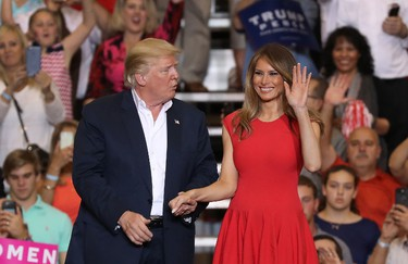 U.S. President Donald Trump and Melania Trump stand together during a campaign rally at the AeroMod International hangar at Orlando Melbourne International Airport on Feb. 18, 2017 in Melbourne, Fla. (Joe Raedle/Getty Images)