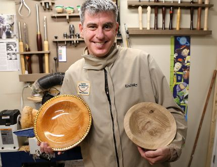 Quinte Woodturners Guild member, David Wheeler holds up one of his finished pieces alongside an in-progress piece on Friday February 17, 2017 in Trenton, Ont. Guild members will be donating more than 40 hand-crafted wooden bowls to the Empty Bowls fundraiser at Loyalist College. Proceeds from the event will go towards eight foodbanks in the region. Tim Miller/Belleville Intelligencer/Postmedia Network