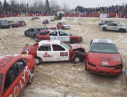 Cars crash into each other in the second heat of the Cochrane Demolition Derby on Sunday.