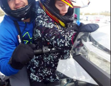 This year's Easter Seals Ambassador Brooke Niemi gets on her snowmobile with Trevor Niemi to particpate in the 2017 Snowarama in Timmins