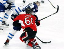 Mark Stone hit by Jacob Trouba