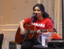 "Tianna Legacy, 14, entertains with an original song, ""United in Canada"", during the seventh annual Immigration Forum held in the Sault. She was also selected to sing the National Anthem for the event."