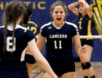 Ursuline Lancers' Sammi Vlasman (11) celebrates after winning a point against the CKSS Golden Hawks during the LKSSAA 'AAA' senior girls volleyball final Friday at Chatham-Kent Secondary School. The Lancers won in four sets. (MARK MALONE/The Daily News)