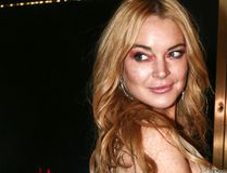 """This Oct. 16, 2016 file photo shows actress Lindsay Lohan at the entrance of the Lohan Nightclub during the opening night in Athens, Greece. New York state's highest court has agreed to allow Lohan to appeal her lawsuit against the makers of """"Grand Theft Auto,"""" who the actress says used her likeness in the video game without permission. (AP Photo/Yorgos Karahalis, File)"""