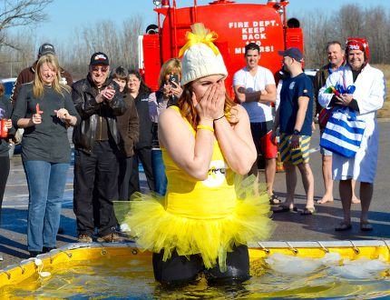Petrolia's Dr. Lisa Thompson reacts as she tests icy cold waters during a recent polar dip in the community. The event raised over $5,000 for safeTALK training, to instruct individuals on how to react when someone shows signs of depression. Melissa Schilz/Postmedia Network