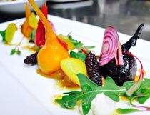 Wine poached beets with berries and micro-greens. (Jagger Gordon photo)