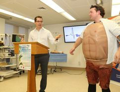 Dr. Rob Anderson, left, medical lead of Health Sciences North Simulation Laboratory, introduces simulation technician Tyler Montroy at the launch of Health Sciences North Foundation Taste St. Beach Party fundraiser in Sudbury, Ont. on Wednesday February 22, 2017. Montroy wore a cut suit used in simulation training. John Lappa/Sudbury Star/Postmedia Network