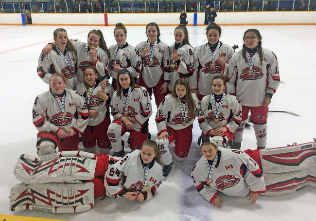 The Cornwall bantam Typhoons won gold again. In front, from left, are Emma Jamieson and Avery Brown. Kneeling are Katherine Thomson, Brenna Cameron, Mikaela Coleman, Sara O`Brien and Karah White. At back are Chloeanne Sequin, Maevin Wylie-Arbic, Millie King, Savahna Vachon, Quinn Mulhearn, Anabelle Ferland and Samantha Graveley. Missing is Madison Besner.   Handout/Cornwall Standard-Freeholder/Postmedia Network