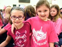 Isabel Campbell Public School students and friends Emma Bateman (left) and Lauryn Fraser enjoyed the school's Pink Shirt Day assembly on Wednesday in Grande Prairie. The school unveiled a portrait of its namesake painted by Chris Kinderwater, the father of the school's Prime Minister Sydney Kinderwater. The school also unveiled its new pink shirts. Svjetlana Mlinarevic/Grande Prairie Daily Herald-Tribune/Postmedia Network