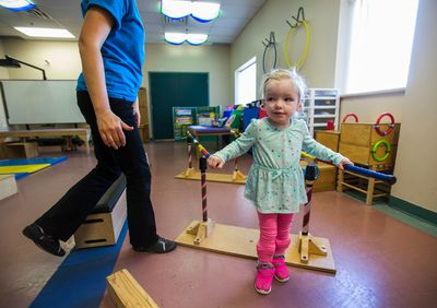Madi Ambos, 3, during a conductive education class at the March of Dimes in Toronto, Ont. on Thursday February 23, 2017. Ambos, who has cerebral palsy, has raised thousands to go to St. Louis for a life-changing operation. OHIP has only just  approved funding today for the procedure. Ernest Doroszuk/Toronto Sun/Postmedia Network