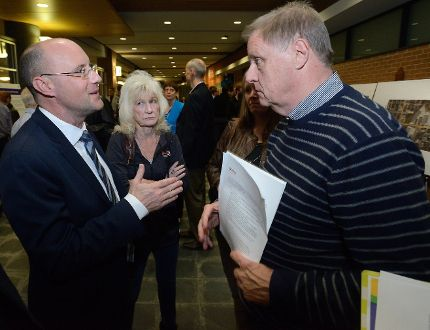 Mayor Matt Brown speaks to Elaine Sawyer and Mike Smith, both members of London's business community, during a public information meeting on the city's rapid transit proposal Thursday at the Central Library. (MORRIS LAMONT, The London Free Press)