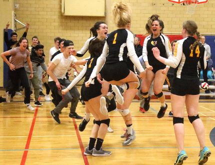 Jubilant fans rush the court as members of the Oakridge Oaks celebrate their WOSSAA senior girls volleyball championship Thursday night in London. The host Oaks rallied to beat Lucas Vikings 3-2 to advance to the OFSAA provincial championship. (MIKE HENSEN, The London Free Press)