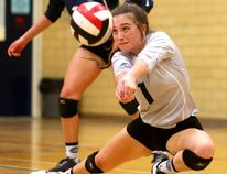 Taylor Mizzi of the Lucas Vikings bumps up a spike with teammate Hailey Knox behind her during their WOSSAA championship in senior girls volleyball held at Oakridge Secondary School in London, Ont. on Thursday February 23, 2017. (MIKE HENSEN, The London Free Press)