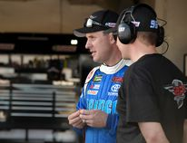 D.J. Kennington, left, watches crew members work on his car during practice for Sunday's Daytona 500 at Daytona International Speedway in Daytona Beach, Fla., Friday, Feb. 24, 2017. (AP Photo/Phelan M. Ebenhack)