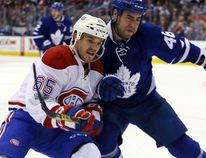 Maple Leafs defenceman Roman Polak (right) battles for position with Andrew Shaw of the Canadiens during NHL action at the Air Canada Centre in Toronto on Saturday, Feb. 25, 2017. (Dave Abel/Toronto Sun)